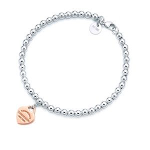 Tiffany & Co Bracelet in silver + rose gold heart charm